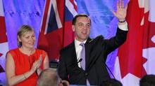 Ontario Progressive Conservative leader Tim Hudak waves with his wife Debbie Hutton before conceding defeat in Ontario's election in Grimsby, Ontario June 12, 2014. (FRED THORNHILL/REUTERS)