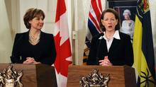 British Columbia Premier Christy Clark, left, and Alberta Premier Alison Redford. A study of global gender equity says Canada lags in female representation in politics. (DAN RIEDLHUBER/REUTERS)