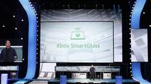 Marc Whitten, the head of Xbox Live, demonstrates the new XBox feature XBox SmartGlass, using a wireless tablet controller at the Microsoft XBox news briefing during the E3 game expo in Los Angeles, California June 4, 2012. The new software application unveiled Monday will connect Xbox game consoles to tablets and smartphones, turning mobile devices into a second screen for gaming and entertainment. (FRED PROUSER/REUTERS)