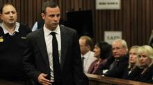 Oscar Pistorius arrives for his trial at the high court in Pretoria, South Africa, Monday, March 3, 2014. (THEMBA HADEBE/AP)