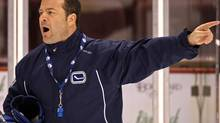 Alain Vigneault has received a three-year contract extension from the Vancouver Canucks. (DARRYL DYCK/CP)