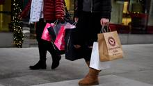 Shoppers carry bags from a number of stores including Abercrombie & Fitch and Victoria's Secret along Fifth Avenue in the Manhattan borough of New York on Nov. 20. (Mark Kauzlarich/Reuters)