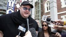 Megaupload founder Kim Dotcom stands next to his wife Mona as he talks to members of the media after he left the High Court in Auckland February 29, 2012. (STRINGER/NEW ZEALAND/Simon Watts/Reuters)