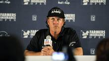 Phil Mickelson listens to a question about comments he made regarding taxes (Denis Poroy/AP)