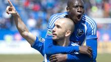 Montreal Impact's Marco Di Vaio, left, celebrates with teammate Hassoun Camara after scoring against the Columbus Crew during second half MLS soccer action in Montreal, Sunday. (Graham Hughes/THE CANADIAN PRESS)