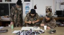 Si Robertson, Jase Robertson and Justin Martin work on a sketch during filming for A&E's Duck Dynasty (Handout/NYT)