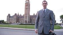 Former Tory staffer Michael Sona poses in front of the Peace Tower in an image taken from his Facebook page.
