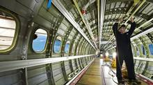 Cascade Aerospace is a specialty aerospace and defence contractor focused on building long-term relationships with customers by meeting their unique needs for high value, complex programs. An employee works on the interior of an aircraft.