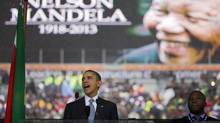 President Barack Obama speaks to crowds attending the memorial service for former South African president Nelson Mandela at the FNB Stadium in Soweto near Johannesburg, Tuesday, Dec. 10, 2013. World leaders, celebrities, and citizens from all walks of life gathered on Tuesday to pay respects during a memorial service for the former South African president and anti-apartheid icon. (Evan Vucci/AP)