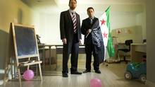 Louay Sakka, right, is an executive member of the U.S.-based Syrian Support Group. He often works out of an office space in his basement in Oakville, Ont., a space he shares with his three children's play area, where a birthday party was recently held. His childhood friend and Oakville neighbour Anas Al-Kassem, left, is a doctor and a fellow Syrian activist who has just returned from a trip to Syria where he was helping to set up field hospitals. (Peter Power/The Globe and Mail)