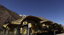 In this May 23, 2013 photo, mining trucks sit parked on the facilities at the Barrick Gold Corp's Pascua-Lama project facilities in northern Chile. (Jorge Saenz/AP)