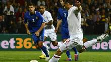 England's Frank Lampard scores a penalty against Moldova during their World Cup 2014 qualifying match at the Zimbru stadium in Kishinev, September 7, 2012. (NIGEL RODDIS/REUTERS)