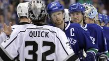 Vancouver Canucks center Henrik Sedin (33) pats Los Angeles Kings goalie Jonathan Quick (32) on the back after the L.A. Kings ended the Canucks season with an overtime win. (BEN NELMS/Reuters)
