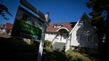 A for sale sign is seen on the lawn of a house for sale in the Kitsilano neighborhood in Vancouver, B.C., on Tuesday September 18, 2012. (DARRYL DYCK For The Globe and Mail)