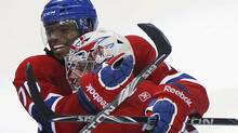 Montreal Canadiens P.K. Subban (L) celebrates his game-winning goal against the Chicago Blackhawks with goalie Carey Price during overtime NHL action in Montreal April 5, 2011. (Reuters)