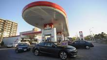 Motorists at a gas station at Overlea Blvd and Leaside Park Crescent in Toronto. (Fred Lum/Fred Lum/The Globe and Mail)