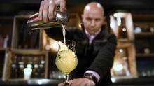 Adrian Stein pours a Fresca mocktail at Mexican restaurant El Caballito, on Jan 5 2015. (Fred Lum/The Globe and Mail)