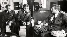 "In this 1962 file photo President John F. Kennedy meets with Air Force Maj. Richard ""Steve'' Heyser, left, and Air Force Chief of Staff, Gen. Curtis LeMay, center, at the White House in Washington to discuss U-2 spy plane flights over Cuba. The CIA in December 2008 censored copies of 1960s-era documents the AP requested under the Freedom of Information Act about former President Gerald Ford's work while still a congressman reviewing Kennedy's assassination, though the government had released the whole memo nearly two decades earlier. (AP)"