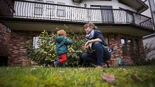 Krista Hilge and her husband ground floor of a house with their dog and two-year-old daughter, Saga Rosenkjaer, in Vancouver. (Ben Nelms for The Globe and Mail)