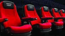 Longueuil, Que.-based D-Box Technologies Inc. creates motion technology for theatres, such as theses moving theatre chairs, which represents about 70 per cent of its revenue. (D-BOX Technologies)