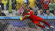 Nigeria's Vincent Enyeama saves a shot against Iran during their 2014 World Cup Group F soccer match at the Baixada arena in Curitiba June 16, 2014. (Ivan Alvarado/Reuters)