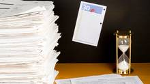 File #: 5196878 Exclusive iStockphoto Photographer Tax Time in Canada Desk with lots of paper, Canadian federal tax form and a page from calendar with the last date to file tax return. Credit: Ireneusz Skorupa / iStockphoto (Royalty-Free) (Ireneusz Skorupa/iStockphoto)