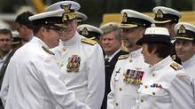 Vice-Admiral Mark Norman, left, greets officers at a change of command ceremony in Halifax on July 12, 2013. (Andrew Vaughan/THE CANADIAN PRESS)