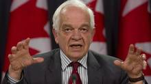 Immigration Minister John McCallum holds a news conference to update the Syrian refugee situation, in Ottawa, Wednesday, December 23, 2015. McCallum says the government will have identified the 10,000 refugees who will be on Canadian soil in the coming months, but not all will be in the air by the end of December. THE CANADIAN PRESS/Fred Chartrand
