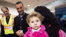 Canada may be welcoming Syrian refugees as a humanitarian act, but it's an act from which the country will also benefit, thanks to the high rates of postsecondary education of immigrants' children. (Nathan Denette/THE CANADIAN PRESS)
