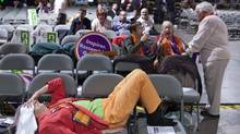 An NDP supporter rests during the third ballot at the party's leadership convention in Toronto on March 24, 2012. (Pawel Dwulit/Pawel Dwulit/The Canadian Press)