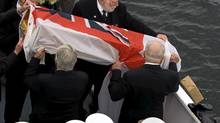 Veterans participate in a burial at sea ceremony on HMCS Sackville, which saw the ashes of 24 members of Canada's military placed in the waters outside Halifax harbour yesterday during a ceremony marking the Battle of the Atlantic. (Andrew Vaughan/The Canadian Press)
