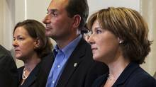Harper may have to smooth the pipeline standoff between Alberta Premier Alison Redford and B.C. Premier Christy Clark, standing to the left and right respectively of PEI Premier Robert Ghiz. (Andrew Vaughan)