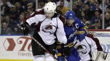 Buffalo Sabres' Jason Pominville (29) battles for the puck with Colorado Avalanche's Jan Hejda (8), of the Czech Republic, during the first period of an NHL hockey game in Buffalo, N.Y., Wednesday, March 14, 2012. (David Duprey/AP)