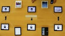 Apple's iPad devices are displayed at its store in Tokyo Jan. 18, 2013. (Kim Kyung Hoon/REUTERS)