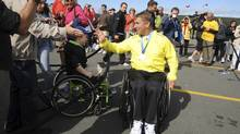 Rick Hansen waves to fans at Cape Spear, Nfld., before the start of the 25th anniversary Rick Hansen Relay on Aug. 24, 2011. (Keith Gosse/The Canadian Press)