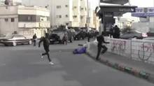 A still from a video supplied by Saudi human rights activists shows Saudi Arabia using armoured vehicles against minority Shia Muslim dissidents in the Mideast country's Eastern Province. (European-Saudi Organisation for Human Rights)