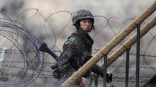 A South Korean soldier walks up the stairs at an observation post, near the demilitarized zone that separates the two Koreas, in Paju, north of Seoul, March 12, 2013. (Kim Hong-Ji/Reuters)