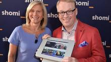 Barbara Williams, VP of content for Shaw and Keith Pelley, president of Rogers Media pose with a tablet showing the new Rogers-Shaw streaming video-on-demand service, Shomi, at the launch event in Toronto, Aug. 26, 2014. (GEORGE PIMENTEL/Handout)
