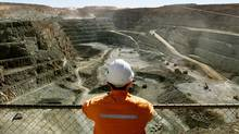 File photo of a miner looking across the largest open pit gold mine in Australia known as the Super Pit, in the gold-mining town of Kalgoolie, located around 500 km east of Perth. (DAVID GRAY/REUTERS)