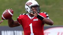 Hamilton Tiger-Cats quarterback Henry Burris throws a pass against the B.C. Lions during first half CFL action in Guelph, Ont., on Saturday, Sept. 7, 2013. (Dave Chidley/THE CANADIAN PRESS)