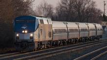 An Amtrak/VIA train from New York to Toronto passes through Oakville April 22, 2013 (For the Globe and Mai/Philip Cheun)