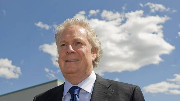 Quebec Liberal Leader Jean Charest smiles as he arrives for a tour of Techniflamme Combustion engineering plant during an election campaign stop in Richmond, Que., Tuesday, August 7, 2012.