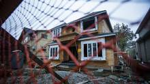 Construction on a new home begins after demolishing the previous house on the lot in the West Point Grey neighbourhood area of Vancouver, British Columbia on October 29, 2015.