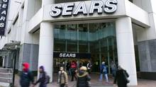 People walk past the main Sears store in downtown Vancouver. (ANDY CLARK/REUTERS)