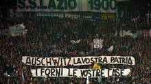 "In this file photo fans of Rome's Lazio soccer team display banners from the stands of Rome's Olympic stadium during Lazio vs Roma Italian first division soccer match in this Sunday, Nov. 29,1998 file photo. The banner directed against the rival's team Jewish supporters reads: ""Auschwitz is your Homeland, the ovens are your homes"". European soccer's governing body UEFA is currently deciding what sanctions to take after the more recent anti-semitic events. (PLINIO LEPRI/AP)"