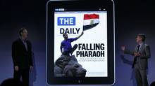 The new online newspaper for the Apple iPad called The Daily is launched by the editor Jesse Angelo (R) on February 2, 2011 at the Guggenheim Museum in New York City. The new media product is owned by News Corp. CEO Rupert Murdoch and will be sold for 14 cents a day. (Spencer Platt/Getty Images)