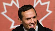 Tampa Bay Lightning GM Steve Yzerman will return as executive director of Canada's men's hockey team at the 2014 Sochi Olympics in Russia. (Nathan Denette/Nathan Denette/The Canadian Press)