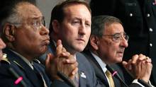 (L-R) Mexican Defense Secretary Guillermo Galvan Galvan, Canadian Defense Minister Peter Mackay and U.S. Secretary of Defense Leon Panetta address a news conference after a trilateral meeting in Ottawa March 27, 2012. (PATRICK DOYLE/REUTERS/PATRICK DOYLE/REUTERS)
