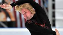 Evgeni Plushenko of Russia performs his short program at the ISU Grand Prix Rostelecom Cup in Moscow on Friday. (YURI KADOBNOV/Yuri Kadobnov/Getty Images)