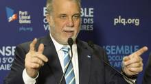 Quebec Liberal leader Philippe Couillard speaks to supporters at the local riding office Thursday, April 3, 2014 while campaigning in Granby, Que. (Ryan Remiorz/THE CANADIAN PRESS)